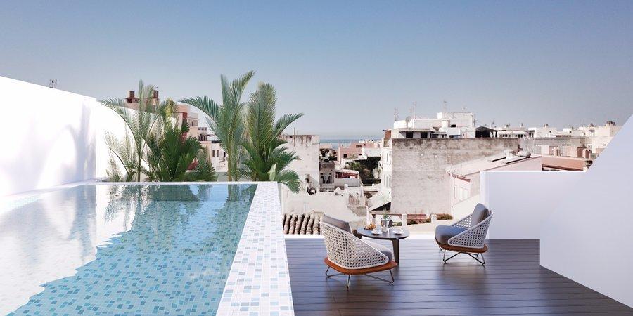 Modernt radhus med takterrass och havsutsikt i Molinar