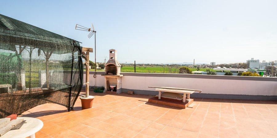 Casa con gran terraza y garaje en el Molinar